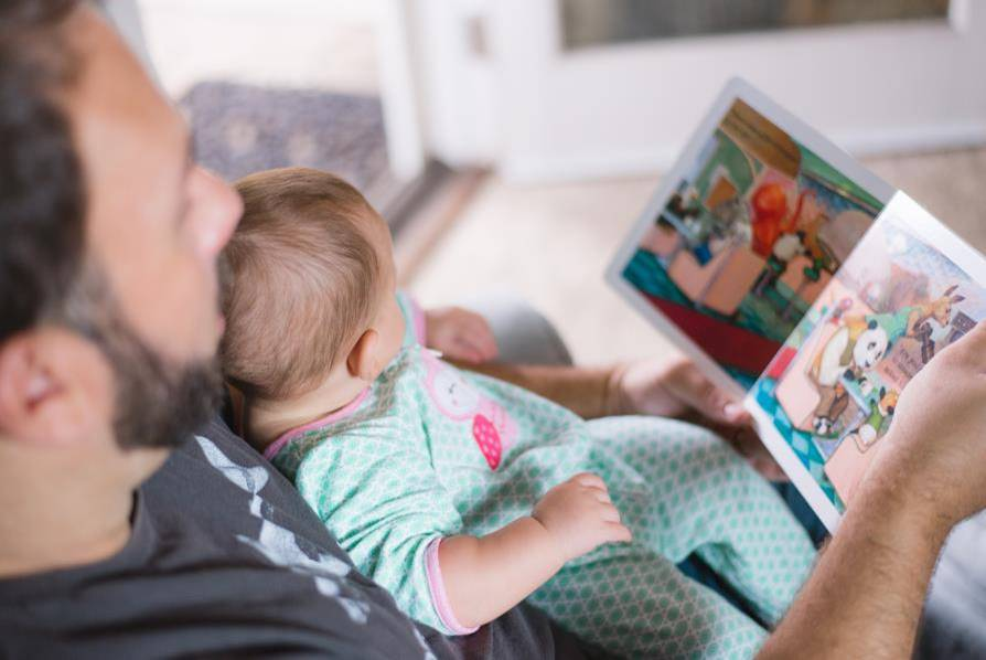 Early-literacy-father reading-to--child