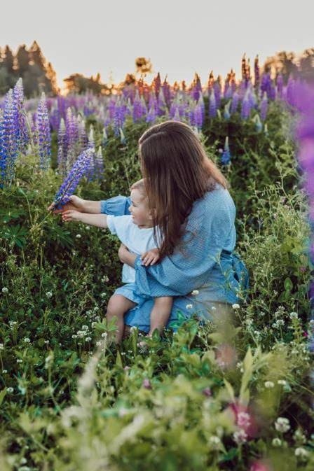 child-picking-flowers-with-Mum